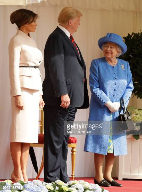 Britain's Queen Elizabeth II talks with US President Donald Trump and US First Lady Melania Trump on the dias in the Quadrangle during a welcome...