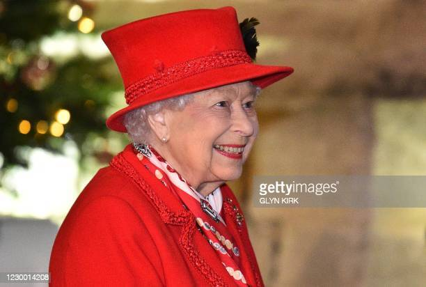 Britain's Queen Elizabeth II thanks local volunteers and key workers for the work they are doing during the coronavirus pandemic and over Christmas...