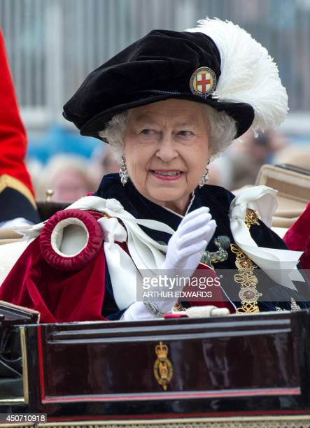 Britain's Queen Elizabeth II travels by carriage after the Most Noble Order of the Garter Ceremony at Windsor Castle in southern England June 16 2014...