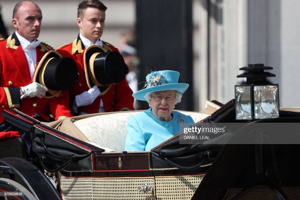 TOPSHOT - Britain's Queen Elizabeth II travels in a horse-drawn carriage to Horseguards parade ahead of her Birthday Parade, 'Trooping the Colour', in London on June 9, 2018. - The ceremony of Trooping the Colour is believed to have first been performed during the reign of King Charles II. In 1748, it was decided that the parade would be used to mark the official birthday of the Sovereign. More than 600 guardsmen and cavalry make up the parade, a celebration of the Sovereign's official birthday, although the Queen's actual birthday is on 21 April.