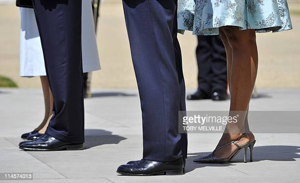 Britain's Queen Elizabeth II US President Barack Obama Prince Philip the Duke of Edinburgh and US First Lady Michelle Obama stand as they listen to...
