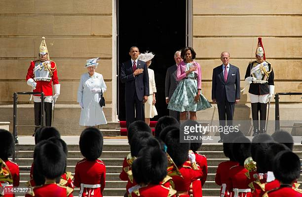 Britain's Queen Elizabeth II US President Barack Obama US First Lady Michelle Obama and Prince Philip the Duke of Edinburgh listen to the American...