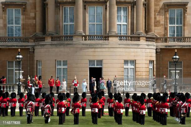 Britain's Queen Elizabeth II US President Barack Obama US First Lady Michelle Obama and Prince Philip the Duke of Edinburgh stand as they listen of...