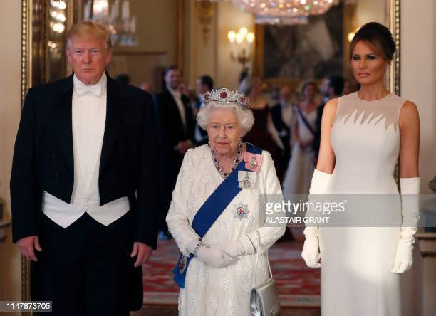 Britain's Queen Elizabeth II US President Donald Trump and US First Lady Melania Trump pose for a photograph ahead of a State Banquet in the ballroom...