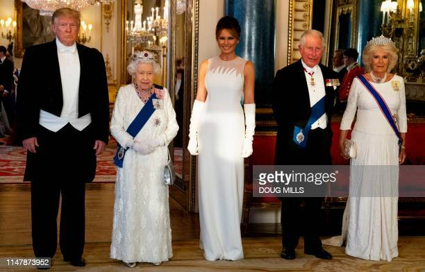 TOPSHOT Britain's Queen Elizabeth II US President Donald Trump US First Lady Melania Trump Britain's Prince Charles Prince of Wales and Britain's...