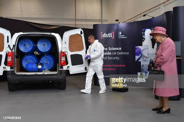 Britain's Queen Elizabeth II views a demonstration of a Forensic Explosives Investigation with a model explosive device in a vehicle at the...