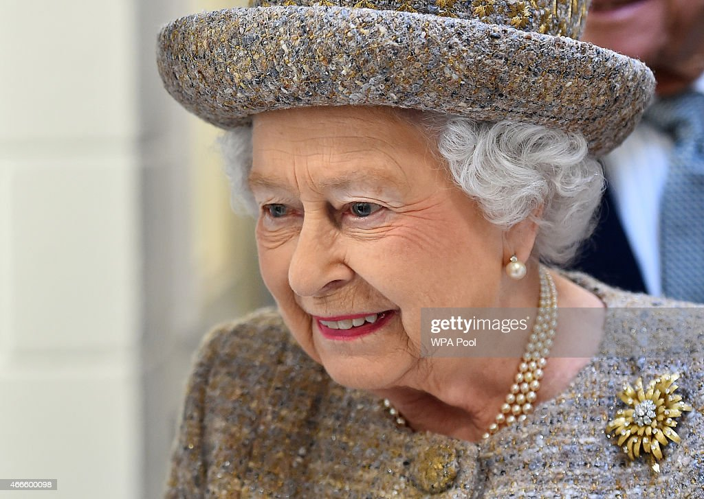 Britain's Queen Elizabeth II visits a kennel block during the opening of the new Mary Tealby dog kennels at Battersea Dogs and Cats Home in London on March 17, 2015.