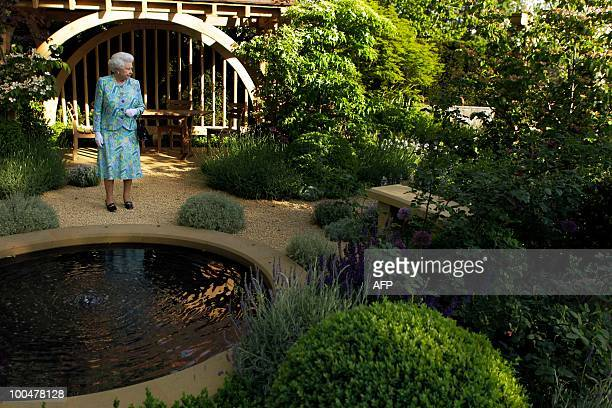 Britain's Queen Elizabeth II visits gardens at the Chelsea Flower Show in London, on May 24, 2010. The show, which has 600 exhibitors, opens to the...