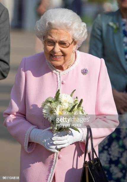 Britain's Queen Elizabeth II visits the 2018 Chelsea Flower Show in London on May 21 2018 The Chelsea flower show held annually in the grounds of the...