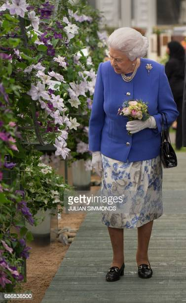 Britain's Queen Elizabeth II visits the Chelsea Flower Show in London on May 22 2017 The Chelsea flower show held annually in the grounds of the...