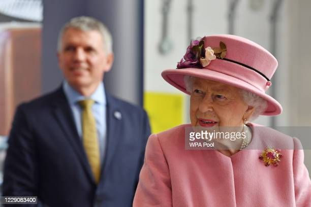 Britain's Queen Elizabeth II visits the Defence Science and Technology Laboratory at Porton Down science park on October 15 2020 near Salisbury...