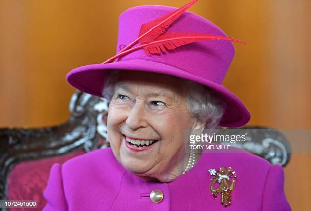 Britain's Queen Elizabeth II visits The Honourable Society of Lincolns Inn to open the new Ashworth Centre and reopen the recently renovated Great...