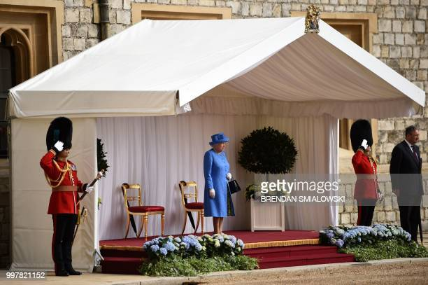 Britain's Queen Elizabeth II waits for the arrival of US President Donald Trump and US First Lady Melania Trump at Windsor Castle in Windsor west of...