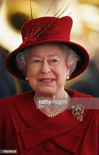 Britain's Queen Elizabeth II waits to greet Qatar's emir Sheikh Hamad bin Khalifa alThani and his wife Sheikha Mozah during a Ceremonial Welcome at...