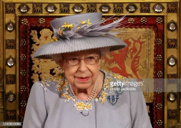 Britain's Queen Elizabeth II waits to read the Queen's Speech on the The Sovereign's Throne in the House of Lords chamber,, during the State Opening...