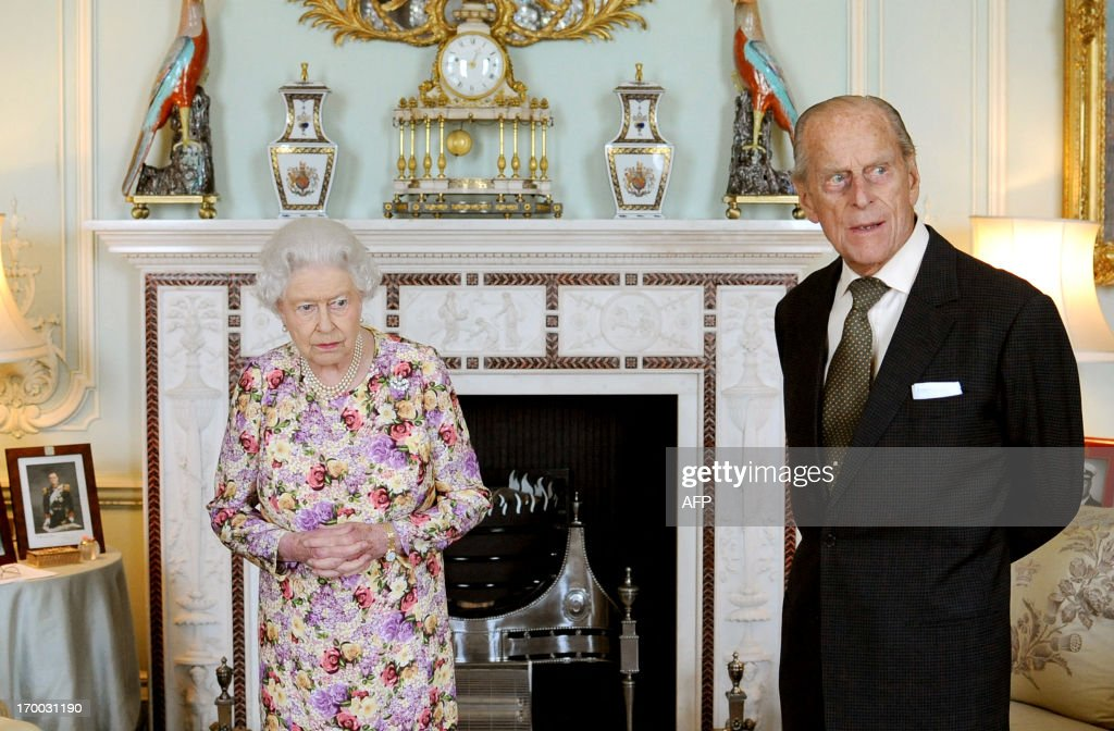 Britain's Queen Elizabeth II (L) waits with Prince Philip, Duke of Edinburgh (R) before presented him with his medal and investing him with New Zealand's highest honour, the Order of New Zealand, at Buckingham Palace in central London on June 6, 2013. Prince Philip was made an additional member of the Order of New Zealand to mark the Queen's Diamond Jubilee. The Queen is the Order's sovereign and additional members are appointed to commemorate important royal, state or national occasions.