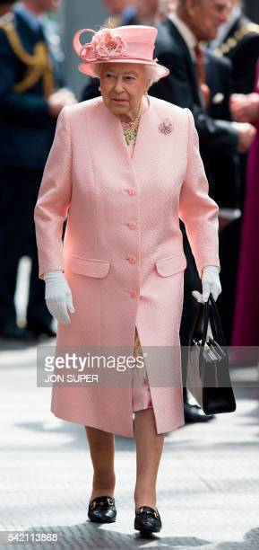 Britain's Queen Elizabeth II walks along the platform after arriving by Royal Train at Liverpool Lime Street Station in Liverpool northwest England...