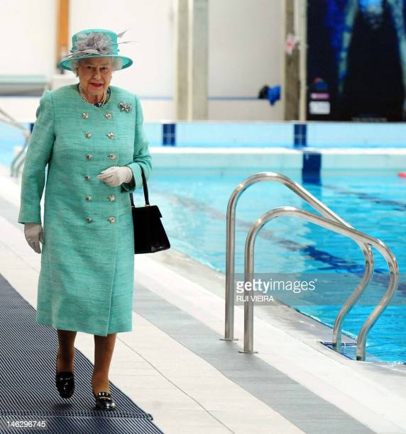 Britain's Queen Elizabeth II walks alongside the Olympic swimming pool at Corby during her diamond jubilee tour of the east Midlands on June 13 2012...