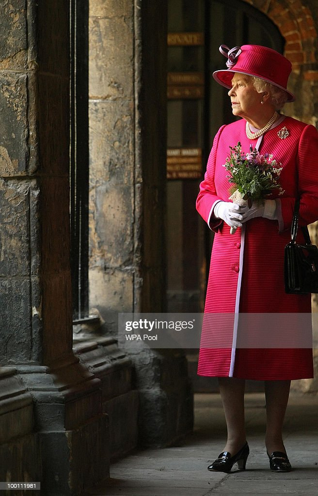 Britain's Queen Elizabeth II walks through the cloisters of Westminster Abbey, during a visit to Westminster Abbey and Westminster School, on the 450th anniversary of the granting of their Royal Charter by Queen Elizabeth I, on May 21, 2010 in London, England.
