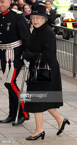 Britain's Queen Elizabeth II walks to the Salvation Army's Booth House February 12, 2002 in London. The Queen, wearning black and in mourning for her...