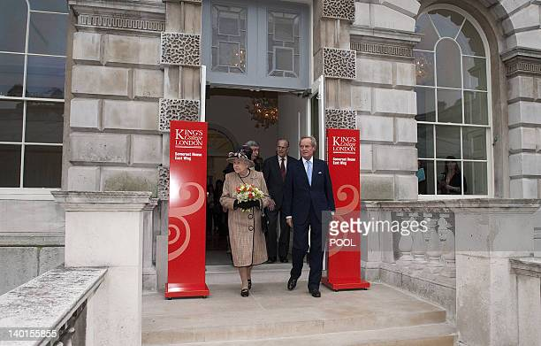 Britain's Queen Elizabeth II walks with Arthur Wellesley, Marquess of Douro, followed by Prince Philip, Duke of Edinburgh, after opening the newly...
