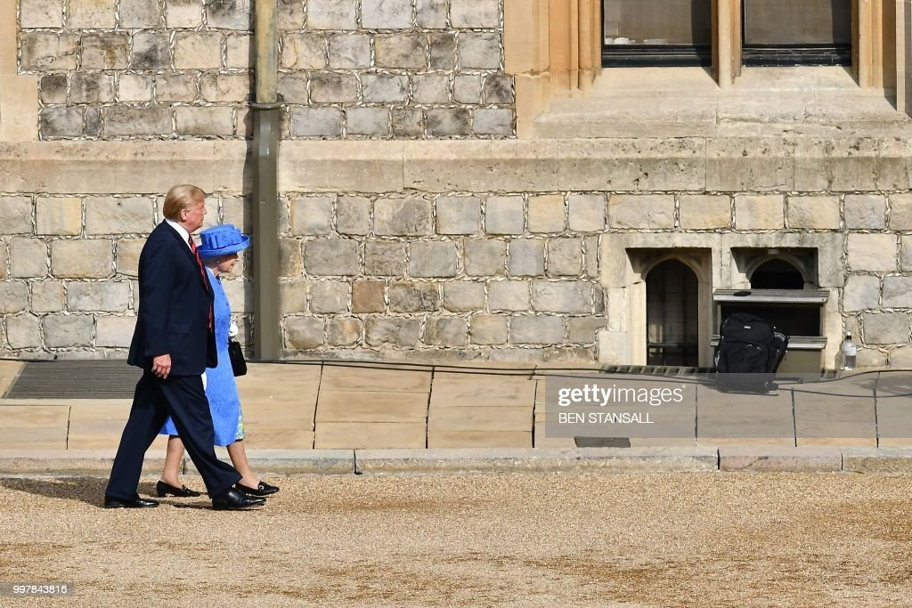 TOPSHOT - Britain's Queen Elizabeth II (R) walks with US President Donald Trump (L) in the Quadrangle at Windsor Castle in Windsor, west of London, on July 13, 2018 for an engagement with Britain's Queen Elizabeth II on the second day of Trump's UK visit. - US President Donald Trump launched an extraordinary attack on Prime Minister Theresa May's Brexit strategy, plunging the transatlantic 'special relationship' to a new low as they prepared to meet Friday on the second day of his tumultuous trip to Britain.
