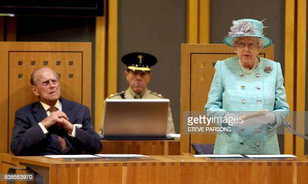 Britain's Queen Elizabeth II watched by Prince Philip Duke of Edinburgh speaks at the opening session of the National Assembly at the Senedd in...