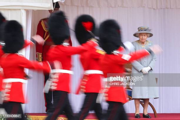 Britain's Queen Elizabeth II watches a military ceremony to mark her official birthday at Windsor Castle on June 12, 2021 in Windsor.