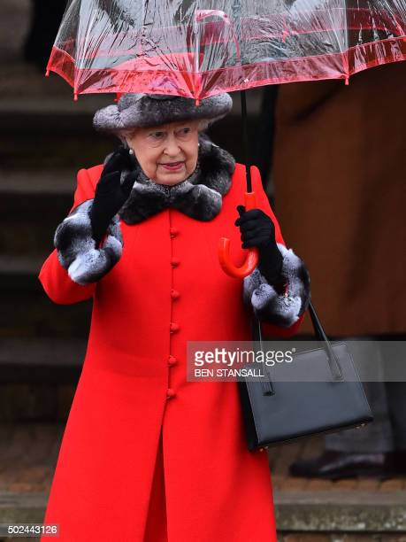 Britain's Queen Elizabeth II waves after attending a traditional Christmas Day Church Service at Sandringham in eastern England on December 25 2015...