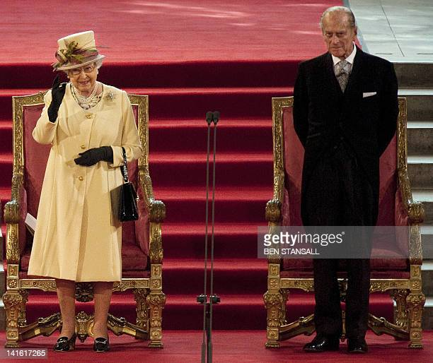 Britain's Queen Elizabeth II waves after giving a speech in response to Loyal Addresses marking her Diamond Jubilee presented to her from both Houses...
