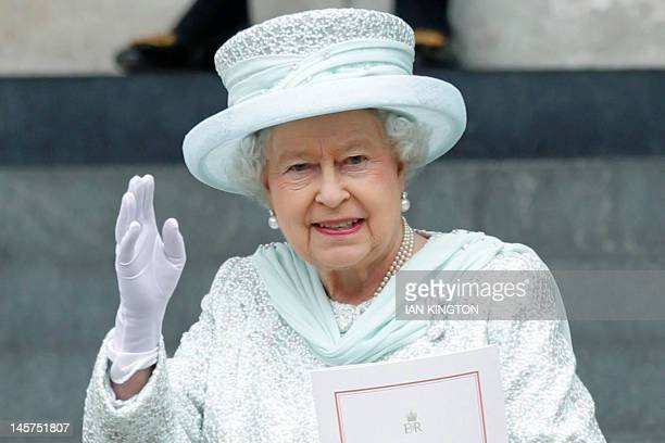 Britain's Queen Elizabeth II waves as she leaves St Paul's Cathedral after a national service of thanksgiving for the Queens Diamond Jubilee at in...