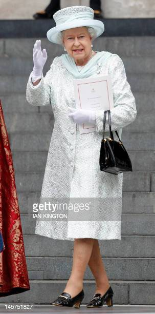Britain's Queen Elizabeth II waves as she leaves St Paul's Cathedral after a national service of thanksgiving for the Queen's Diamond Jubilee at in...