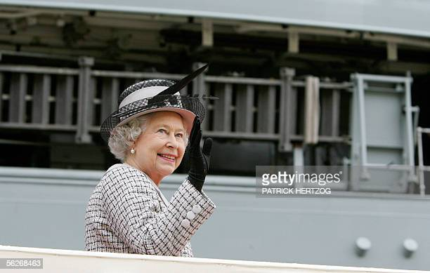 Britain's Queen Elizabeth II waves from the gangway of the British Royal Navy aircraft carrier 'HMS Illustrius' in Valletta's main harbour in Malta...