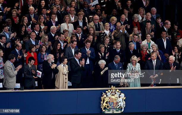 Britain's Queen Elizabeth II waves from the Royal Box surrounded by guests including members of the royal family clergy and members of the British...