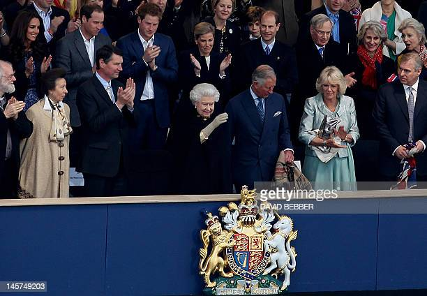 Britain's Queen Elizabeth II waves from the Royal Box surrounded by guests including members of the royal family and the clergy Archbishop of...