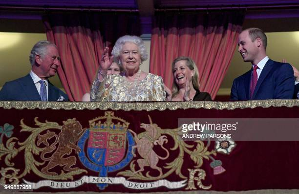 TOPSHOT Britain's Queen Elizabeth II waves to guests as her son Britain's Prince Charles Prince of Wales and grandson Britain's Prince William Duke...