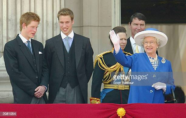 Britain's Queen Elizabeth II waves to the crowd from the balcony of Buckingham Palace as Prince Harry Prince William and Princess Anne look on after...