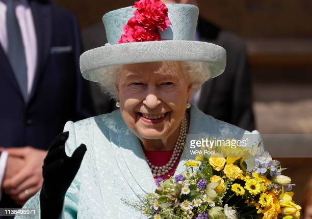 Britain's Queen Elizabeth II waves to the public as she leaves after attending the Easter Mattins Service at St George's Chapel on April 21 2019 in...