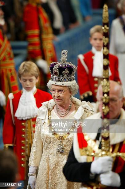 Britain's Queen Elizabeth II wearing the Imperial Crown walks in procession through The Royal Gallery on her way to give her speech during the...