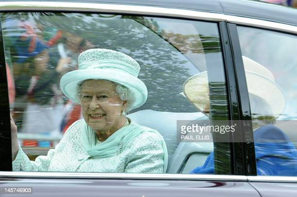 Britain's Queen Elizabeth II with Diana Marion The Lady Farnham drives down the Mall on her way to Saint Paul's Cathedral during the Queen's Diamond...
