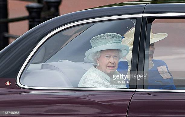 Britain's Queen Elizabeth II with Diana Marion The Lady Farnham drives down the Mall on her way to St Paul's Cathedral during the Queen's Diamond...
