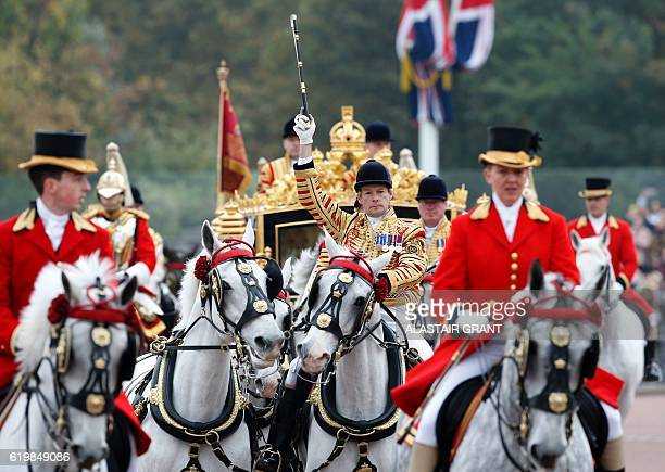 Britain's Queen Elizabeth II with the President of Colombia Juan Manuel Santos arrive by carriage at Buckingham Palace in London on November 1 2016...