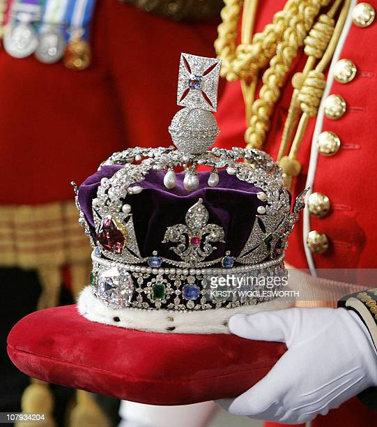 Britain's Queen Elizabeth II's crown is carried out of the House of Lords after the State Opening of Parliament 17 May 2005. The Queen's Speech set...