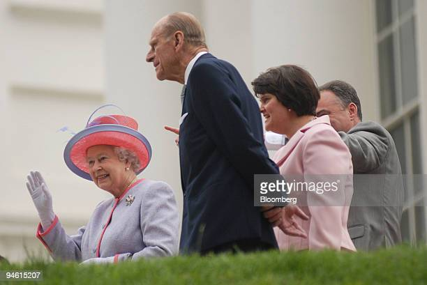 Britain's Queen Elizabeth left and Duke of Edinburgh Prince Phillip center take part in a visit accompanied by the first lady of Virginia Lisa Collis...