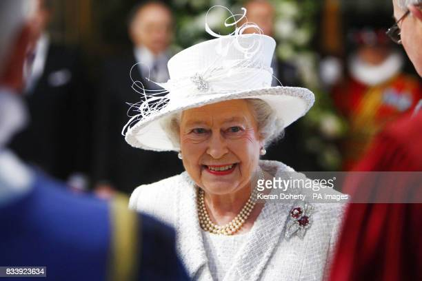 Britain's Queen Elizabeth smiles arrives for the service of celebration to mark the diamond wedding anniversary of Queen Elizabeth II and the Duke of...