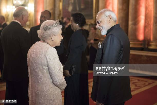 Britain's Queen Elizabeth speaks with India's Prime Minister Narendra Modi before The Queen's Dinner during The Commonwealth Heads of Government...