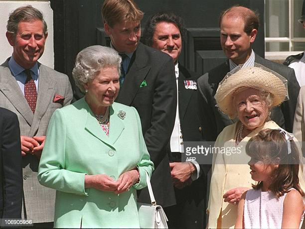 Britain's Queen Elizabeth the Queen Mother stands with her daughter Queen Elizabeth 2 and Royal family members, Prince Charles Prince William and...