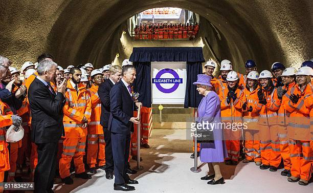 Britain's Queen Elizabeth unveils the new roundel for the Crossrail line that will be known as the Elizabeth line once the line officially opens at...