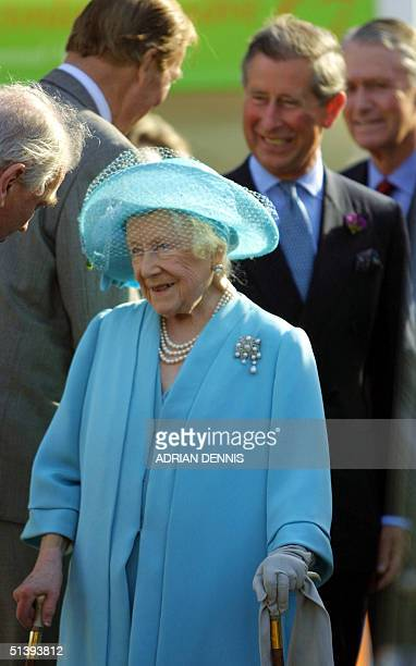 Britain's Queen Mother arrives with her grandson Prince Charles at The Chelsea Flower Show in London 21 May 2001 Prince Charles was exhibiting his...