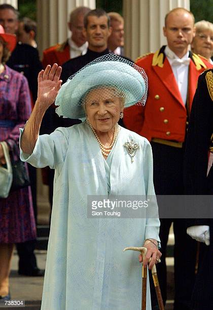 Britain's Queen Mother waves to supporters during celebrations to mark her 101st birthday August 4 2001 in London